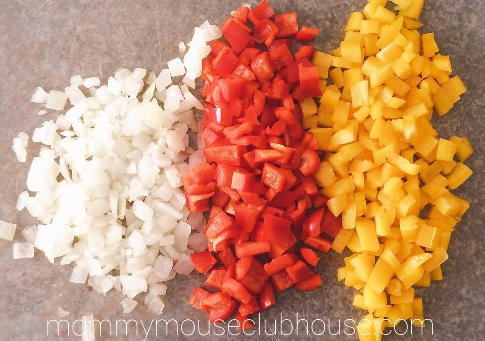 Chopped onions, red peppers and yellow peppers to make Cheesecake Factory's Louisiana Chicken Pasta