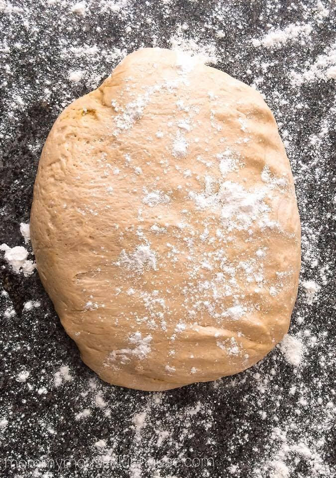 Cake Mix Cinnamon Rolls dough on a floured surface.