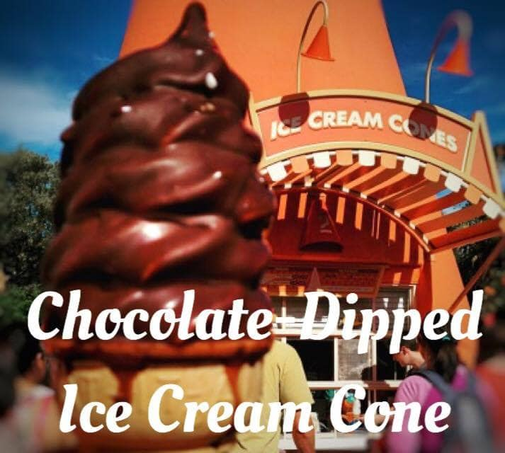 A Chocolate dipped ice cream cone, one of the best Disney snacks, in front of the Cozy Cone Motel at Disney California Adventure