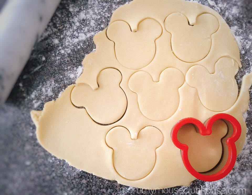 The BEST Sugar Cookie Recipe dough rolled out with a Mickey Mouse cookie cutter.