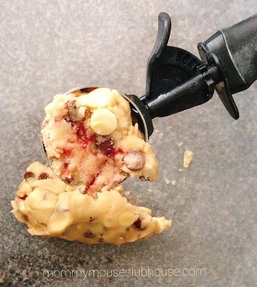 A scoop of Disneyland's Raspberry White Chocolate Chip Cookie Dough