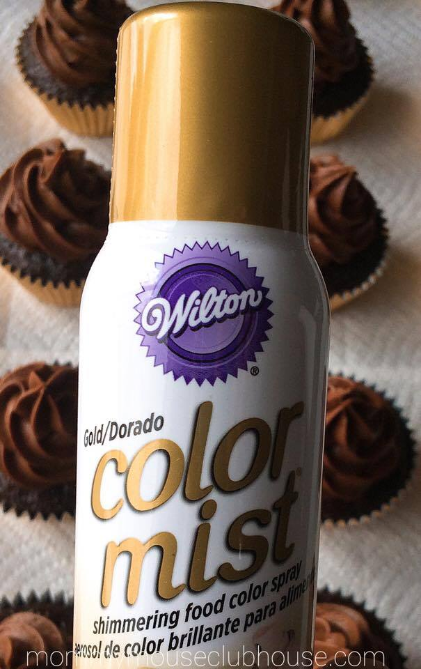 A bottle of Gold food coloring to make Chocolate Salted Caramel Cupcakes