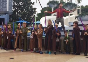 Children on a stage training to be a Jedi