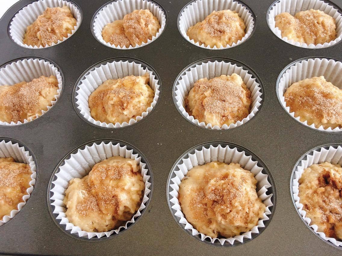 Banana Muffin batter in a muffin pan
