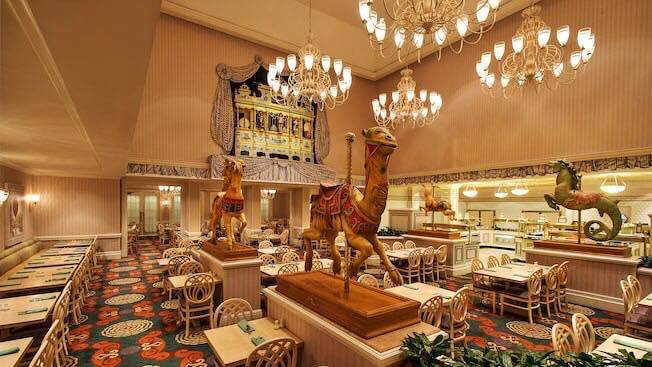 Dining room with tables and chairs, and carousel horses at 1900 Park Fare one of The Best Disney World Character Meals