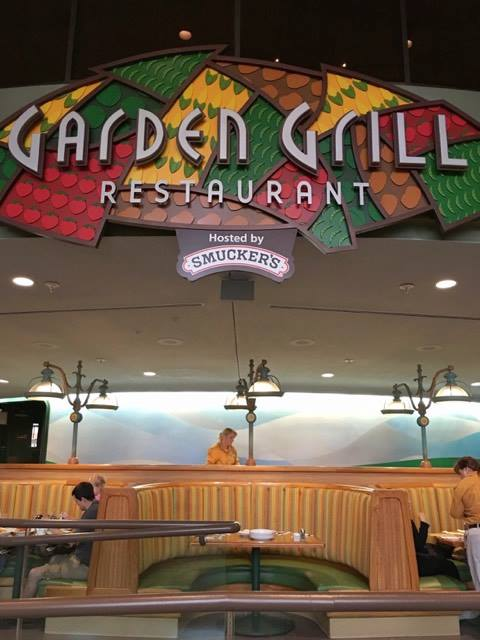 Sign and tables at Garden Grill Restaurant at Epcot