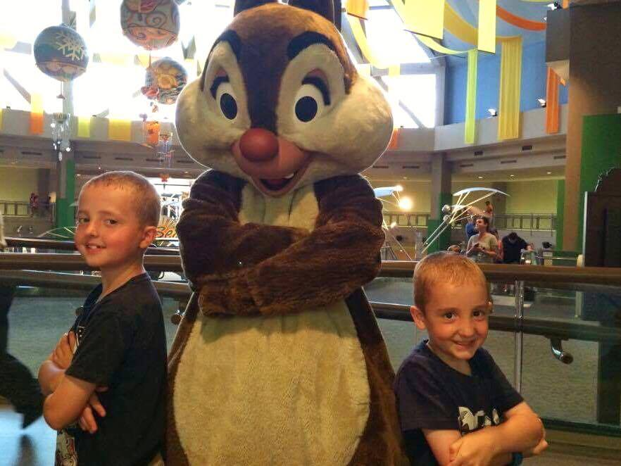 Two boys posed with Chip and Dale at Epcot