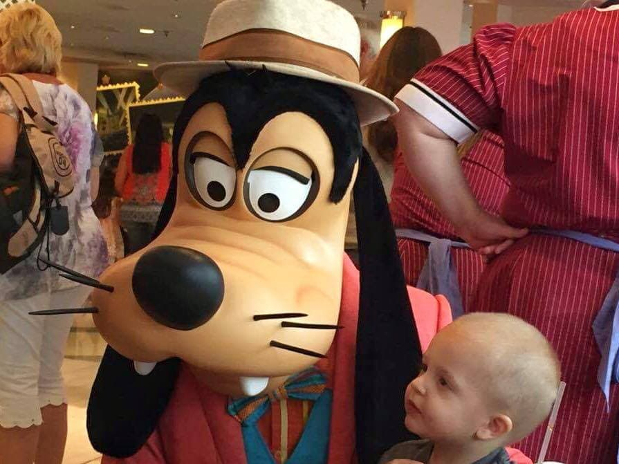 Goofy posed with a baby