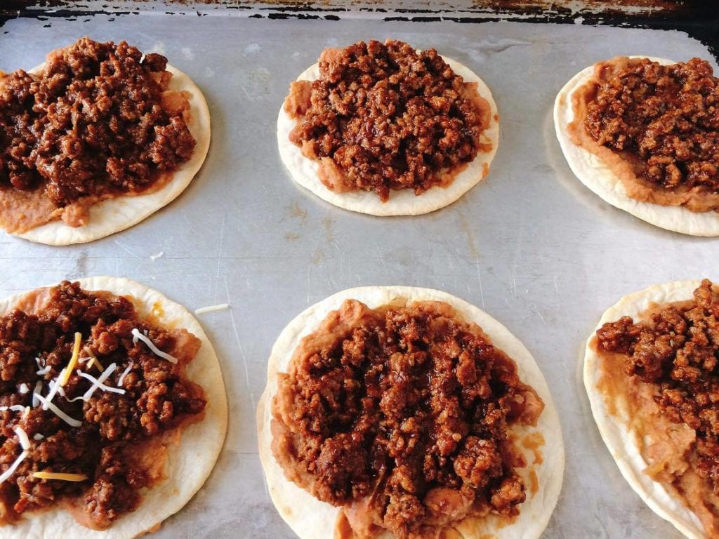 Mini Mexican Pizzas: Taco Bell Style is a homemade copycat recipe of Taco Bell's Mexican Pizza.