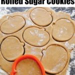 "Text ""Pumpkin Spice Rolled Sugar Cookies"" a pumpkin shaped cookie cutter cutting out Pumpkin Spice sugar cookie dough"