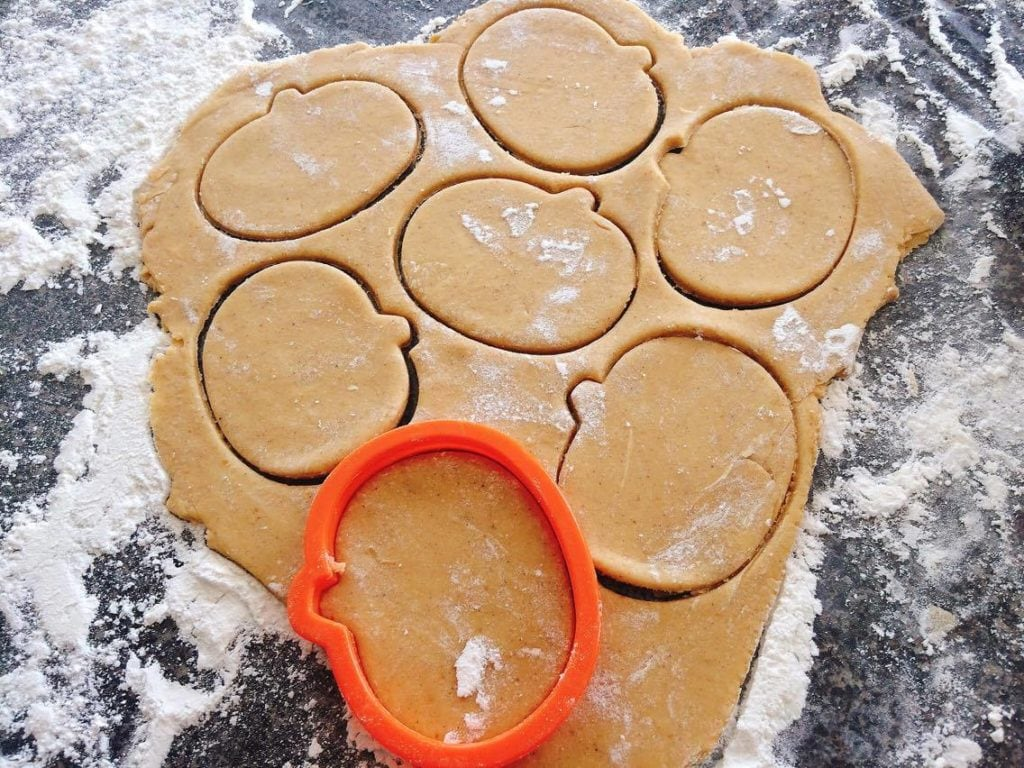 Pumpkin Spice Sugar Cookie dough and a pumpkin cookie cutter