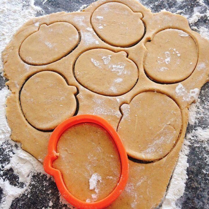 Pumpkin Spice Sugar Cookie dough and a pumpkin cookie cutter
