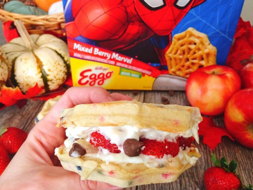 A hand holding a Grilled Sweet Berry Waffle Sandwich
