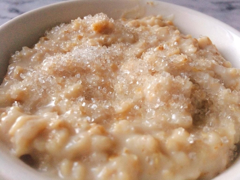 A bowl of oatmeal with sparkling sugar on top