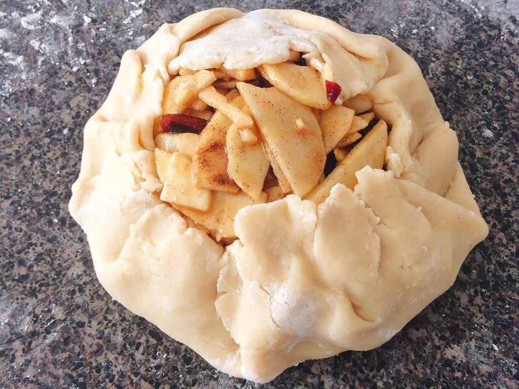 Rustic Apple Pie crust wrapped around pie filling