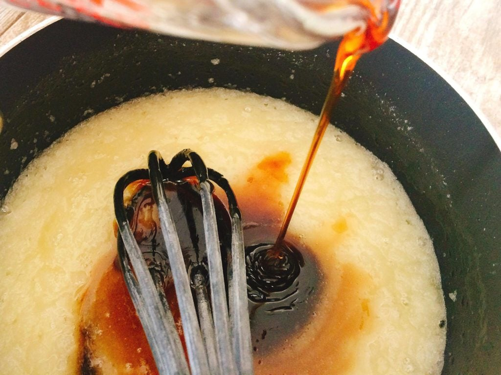 Corn syrup being poured into a pan to make Dark Chocolate Pecan Pie