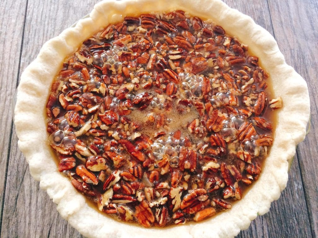 An unbaked Dark Chocolate Pecan Pie