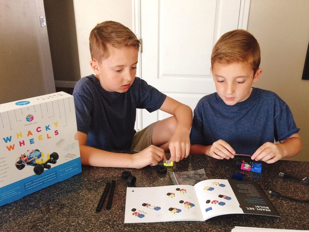 Two boys playing with Circuit Cubes Whacky Wheels