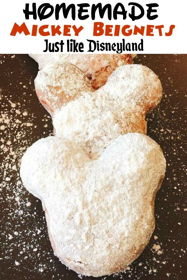"""Homemade Mickey Beignets Just like Disneyland"" over a picture of 3 Mickey shaped beignets covered in powdered sugar."