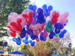Mickey Mouse Balloons in front of a tree