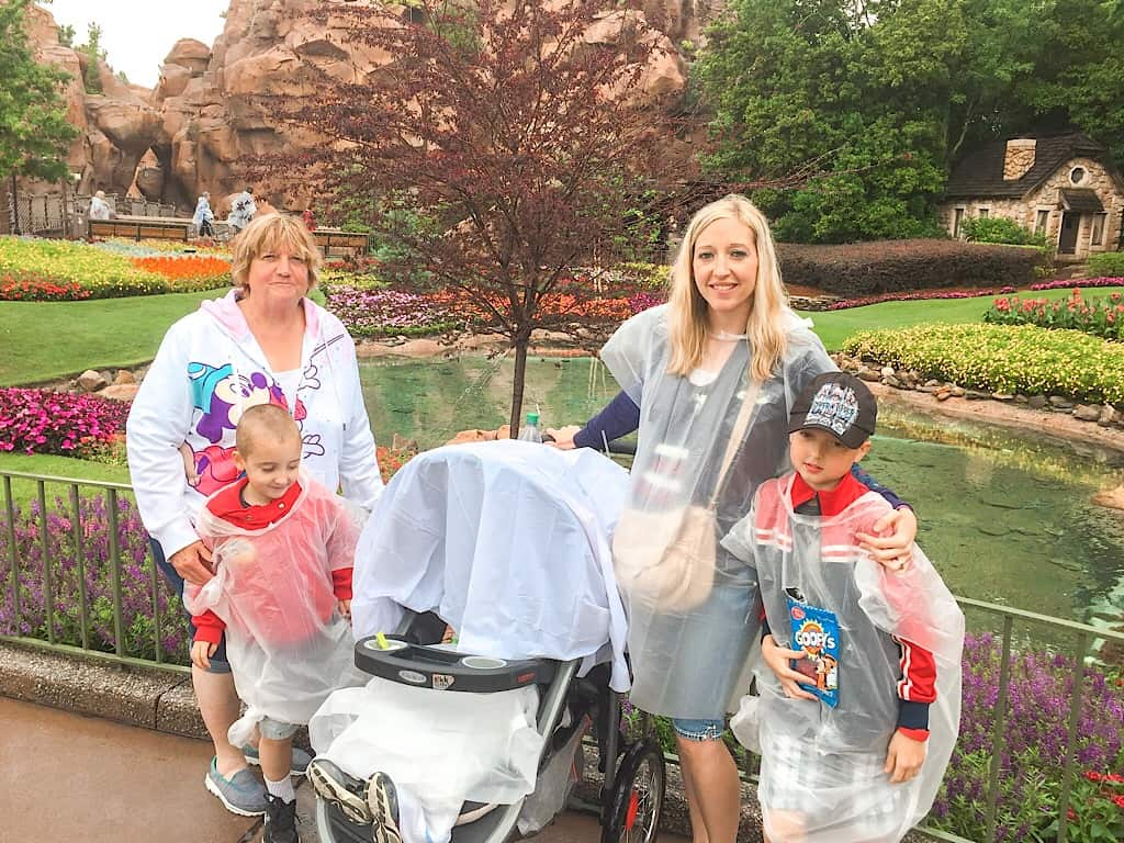 A family in the rain at Epcot