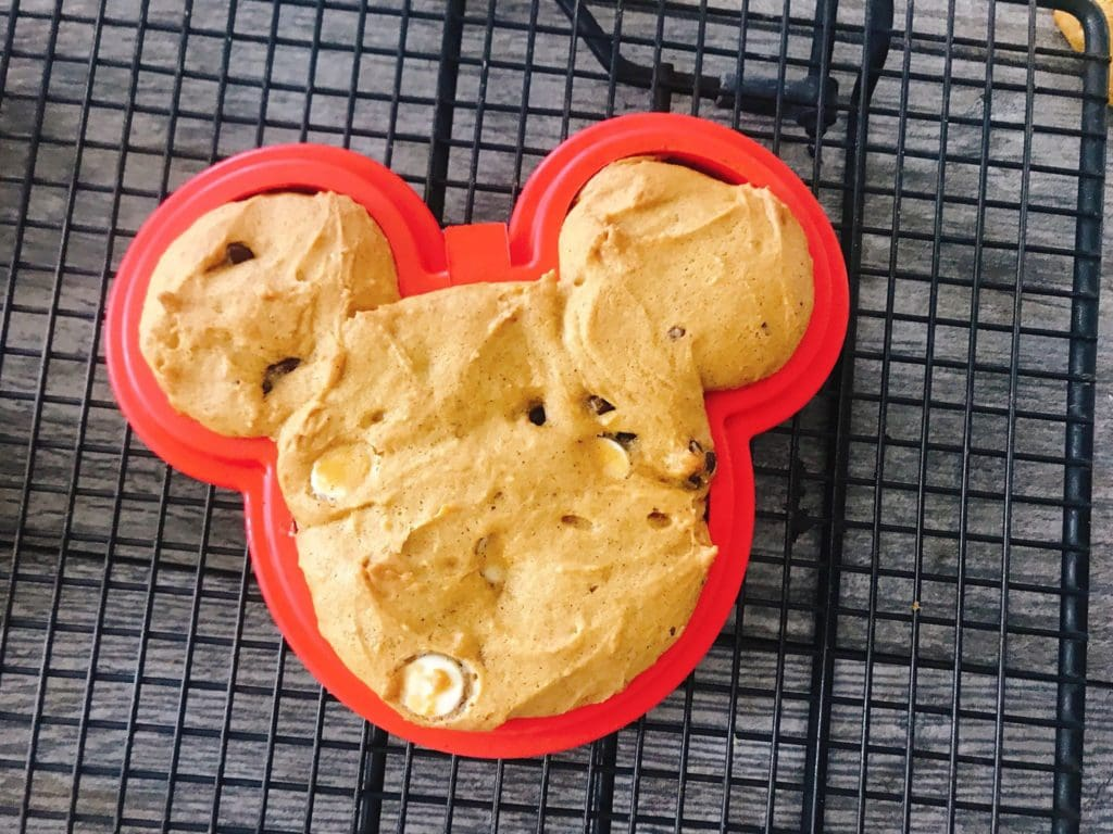 A Mickey Mouse shaped soft pumpkin chocolate chip cookies in a Mickey Mouse mold.