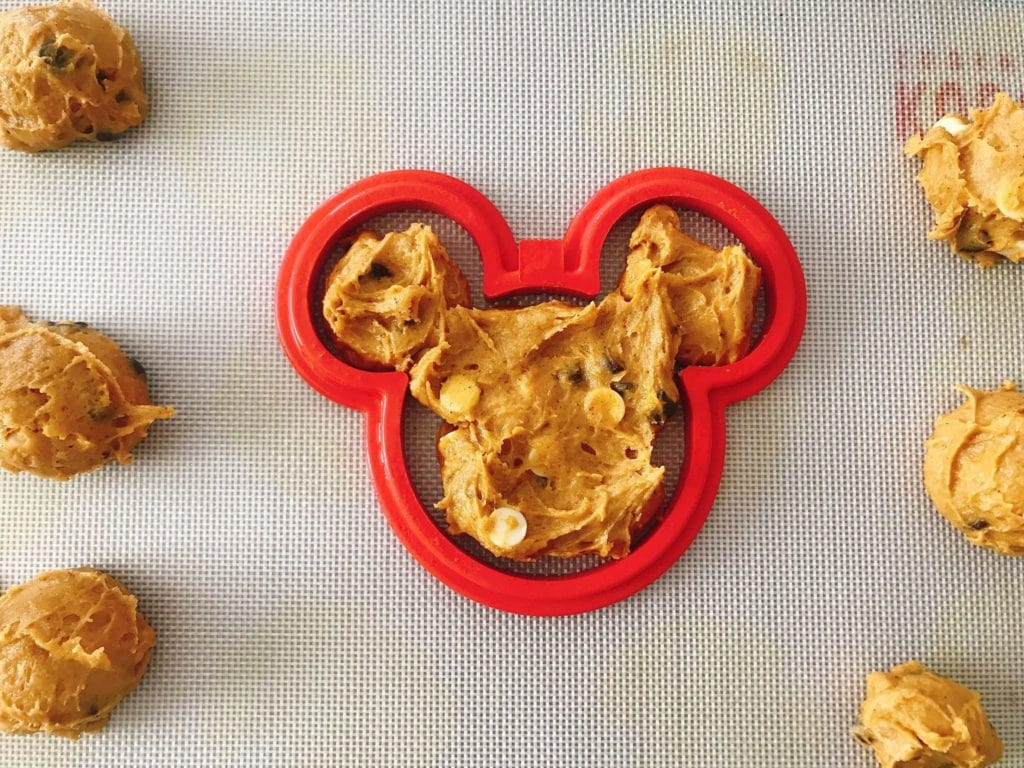 Soft Pumpkin Chocolate Chip Cookies dough in a Mickey Mouse shaped mold.