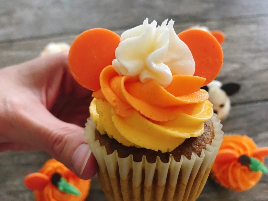 A Close up of a Mickey Mouse Candy Corn Halloween Cupcakes.
