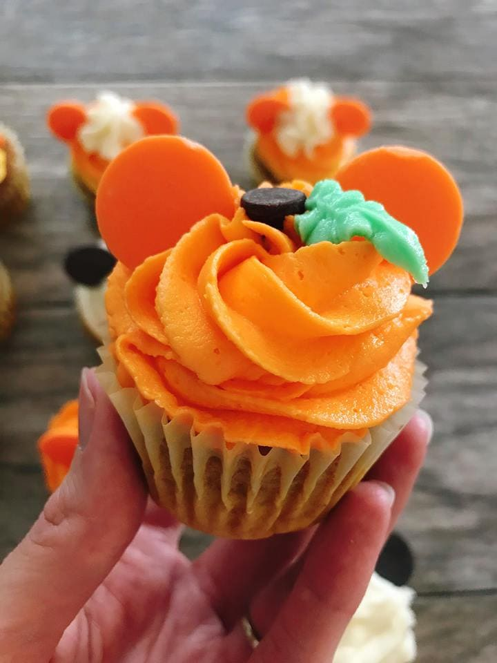 A close up of a Mickey Mouse Pumpkin Halloween Cupcakes.