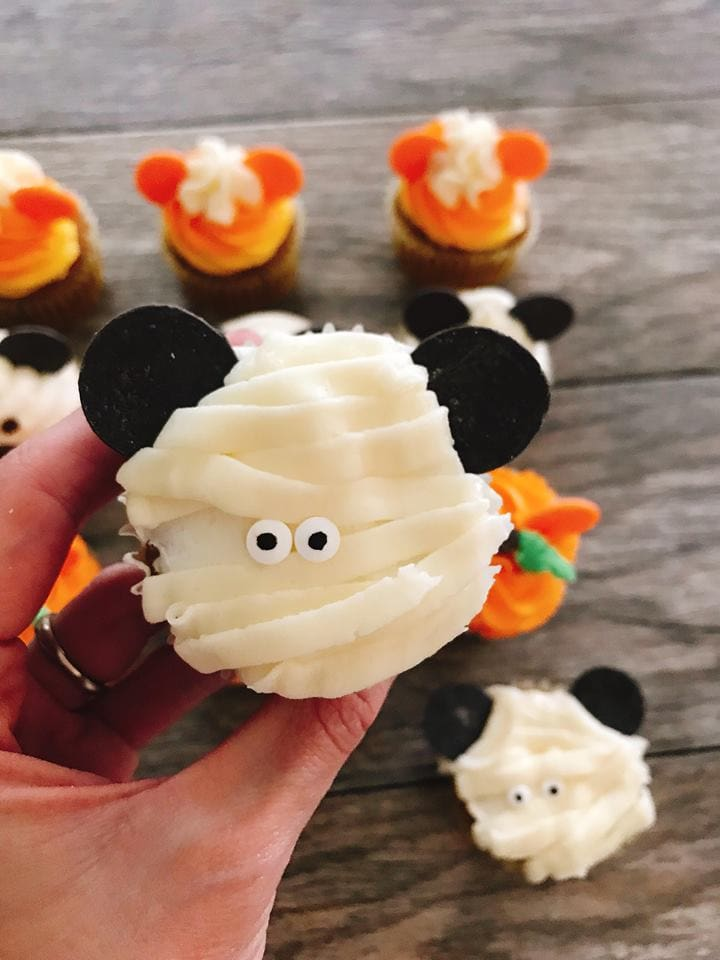 A close up of a Mickey Mouse Mummy Halloween Cupcakes.