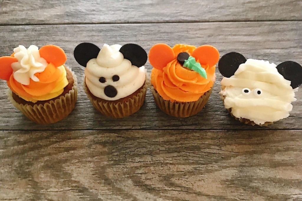 Four different Mickey Halloween Cupcakes in a row.