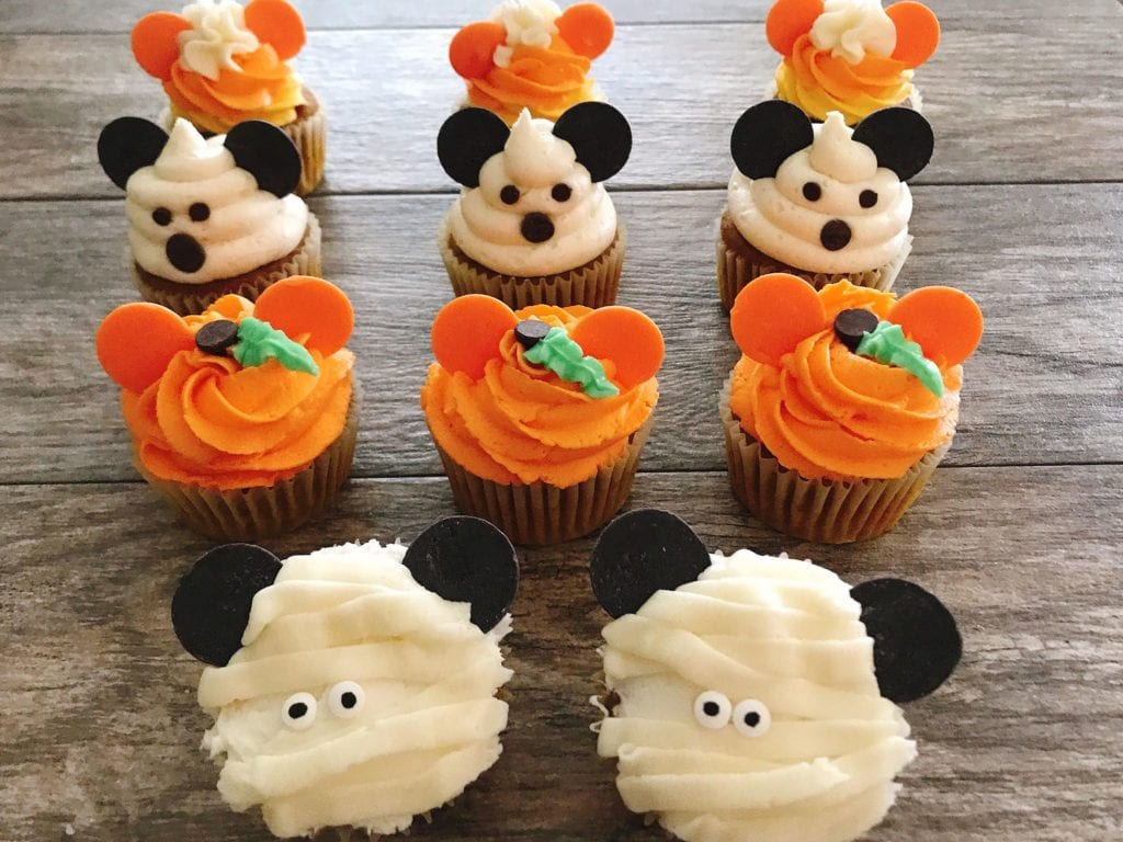 Four different types of Mickey Mouse Halloween Cupcakes.