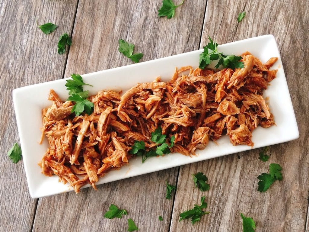 A plate of pulled Sweet Pork Barbacoa like Cafe Rio, sprinkled with cilantro.