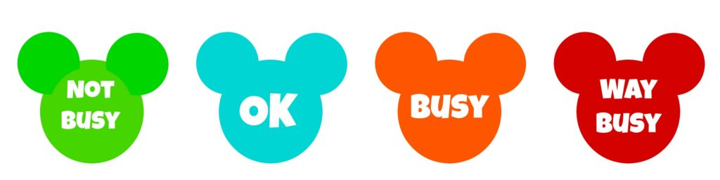 "Green Mickey Head with text ""Not Busy"", Blue Mickey Head with text ""Ok"", Orange Mickey Head with text ""Busy"", Red Mickey Head with text ""Way Busy""."