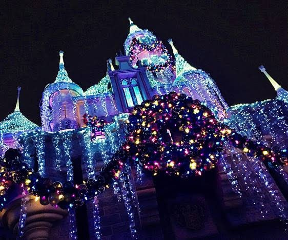 christmas lights decorating sleeping beauty castle for christmas at disneyland