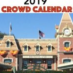 """Text """"Disneyland 2019 Crowd Calendar"""" a picture of the train station at Disneyland."""