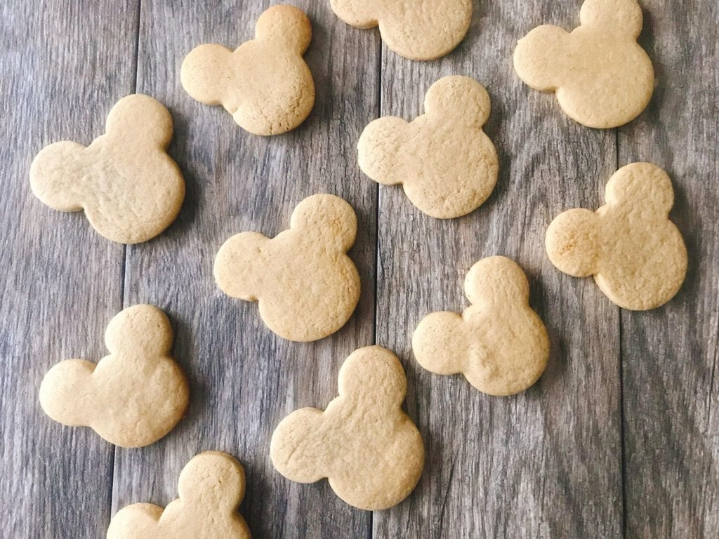 Freshly baked gingerbread sugar cookies shaped like Mickey Mouse.