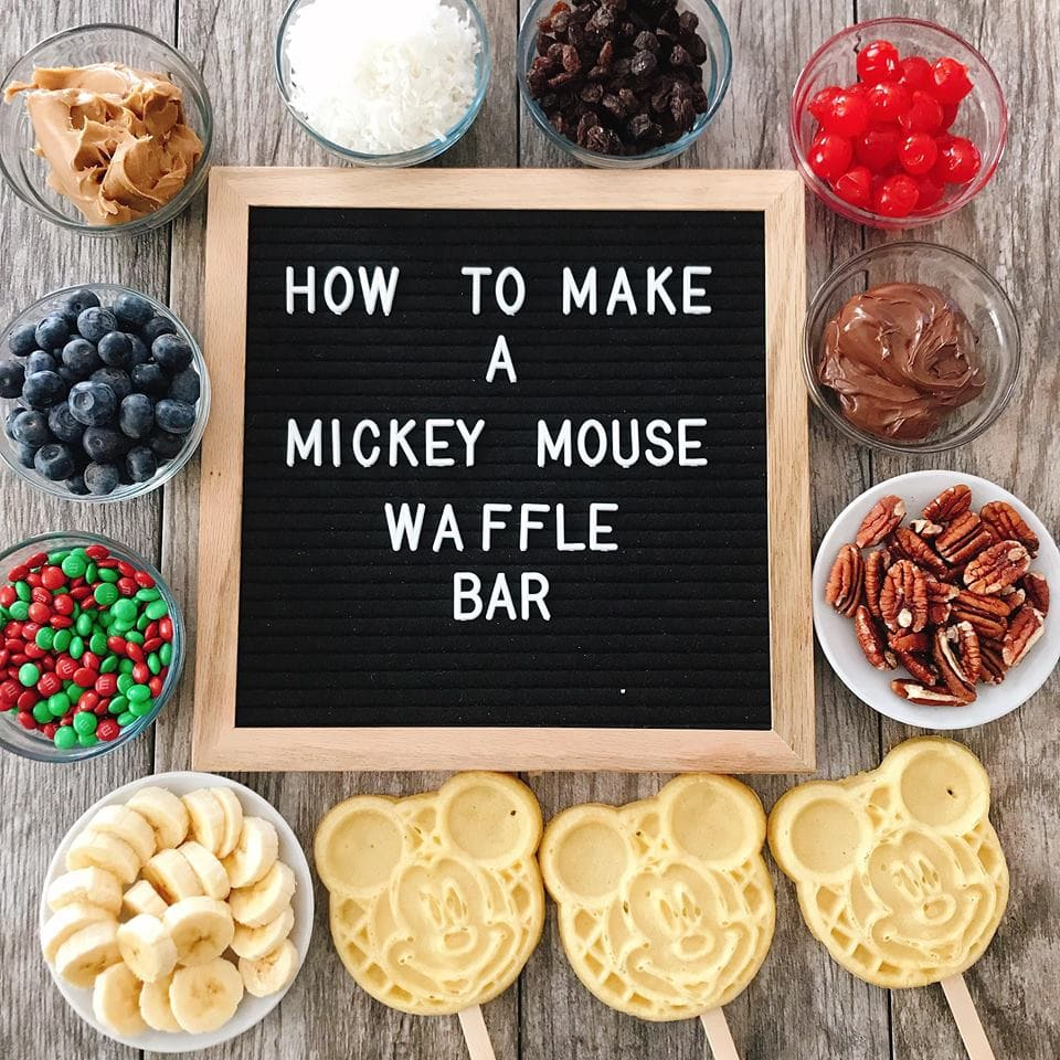 "Waffle bar toppings and Mickey Mose Waffles around a sign that says ""How to Make a Mickey Mouse Waffle Bar"". #wafflebar #waffles #mickeymouse #disney #disneyrecipe #wafflebarideas #wafflebartoppings"