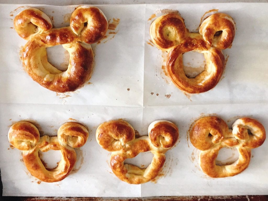Freshly baked Mickey Pretzels on baking sheet