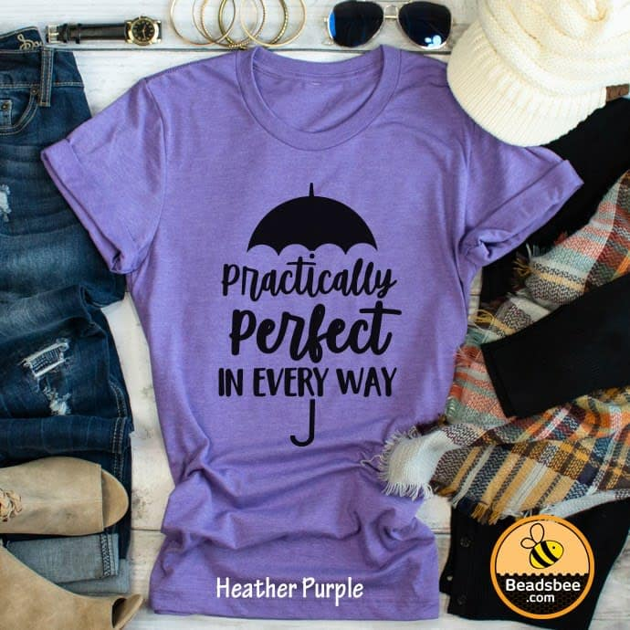 "A purple shirt with an umbrella and text ""Practically Perfect in Every Way"" with other accessories."