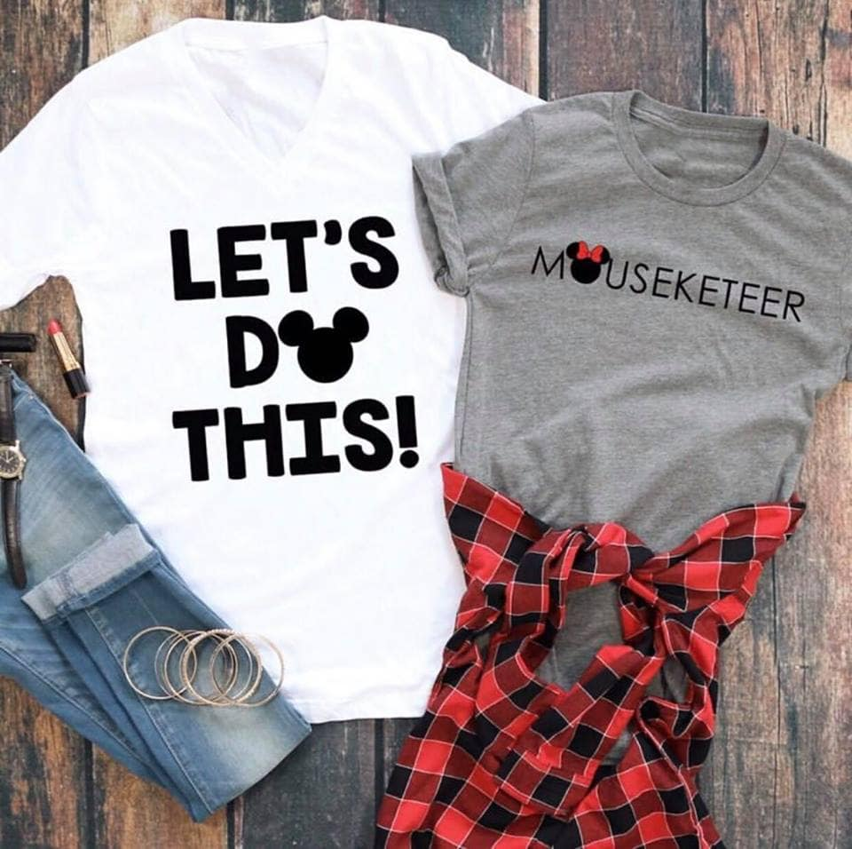 "Two Disney shirts. A white shirt with text ""Let's Do This!"" and a grey shirt with text ""Mouseketeer""."