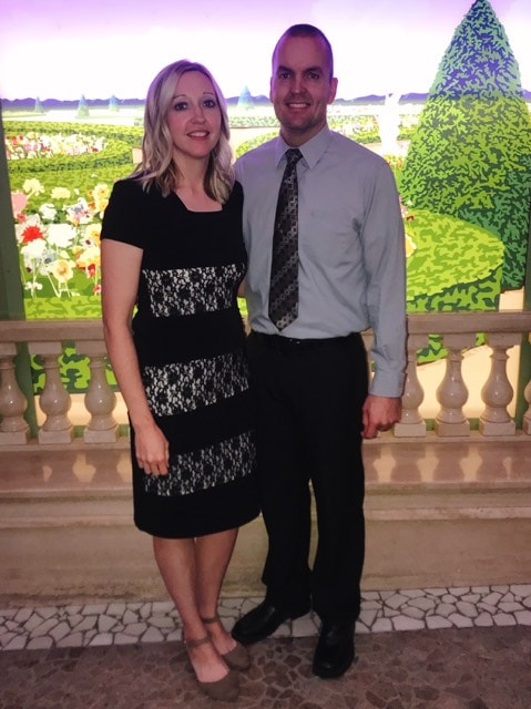 A man and woman dressed up for formal night on a Disney Cruise.