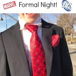 """Text """"Super Hero Suits Perfect for Disney Cruise Formal Night"""" a picture of a boy in a suit with a Spider-Man tie and pocket square."""