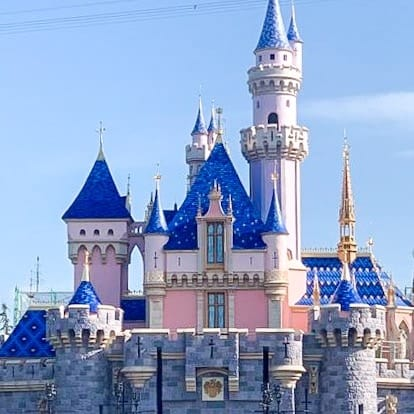 Sleeping Beauty Castle at Disneyland with a blue roof.