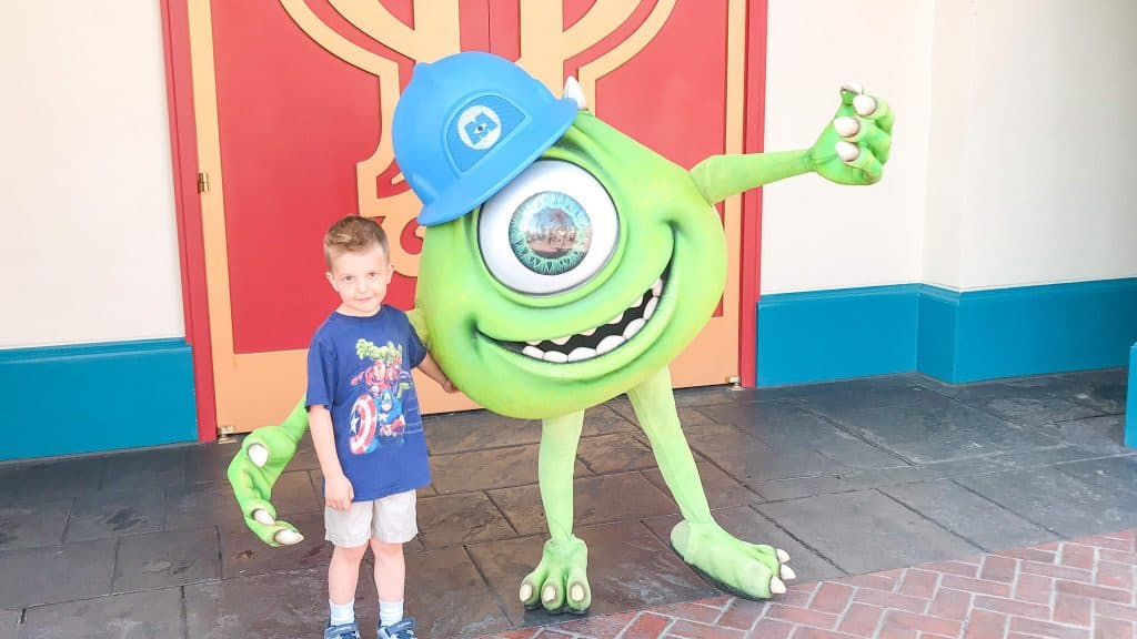 A boy and a monster character at Disneyland.