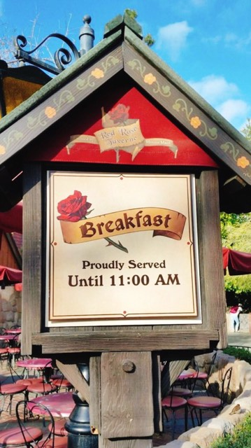 "The sign for Red Rose Tavern at Disneyland that says ""Breakfast Proudly Served Until 11:00 AM"""