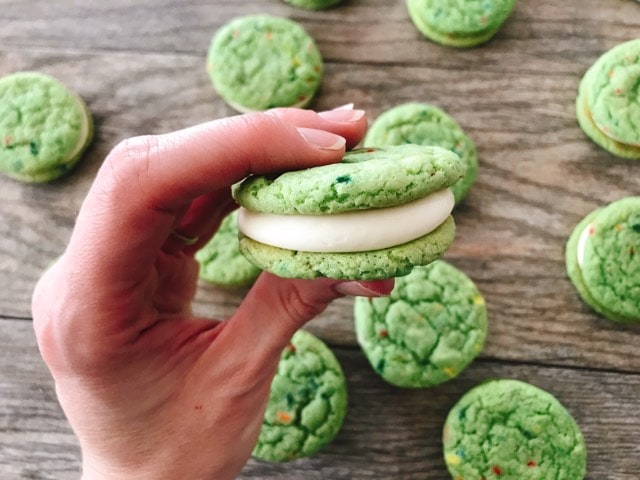 A hand holding a shamrock shake cookie