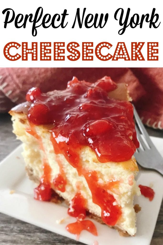 "Text ""Perfect New York Cheesecake"" over a picture of cheesecake topped with strawberry sauce."