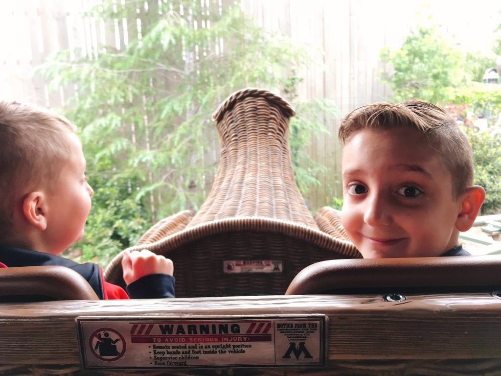 """Two kids riding on a rollercoaster called """"Flight of the Hippogriff"""" at the Wizarding World of Harry Potter at Universal Studios Hollywood."""