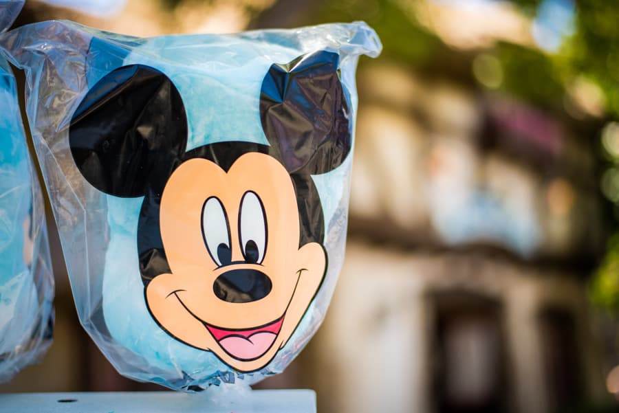 A bag of blue cotton candy with a Mickey Mouse